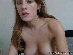 Busty cam girl masturbates with glass dildo
