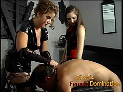 kinky dude enjoys a hard spanking by two hot mistresses