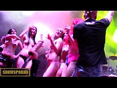 Striptease on stage with live music