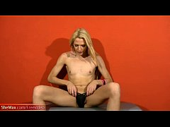 Feminine t-girl pulls out long shemale shaft an...