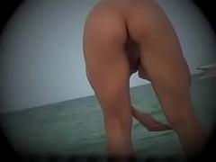 MILF Shows Off Her Asshole At The Nude Beach sea voyeurism voyeurs voyeur spying