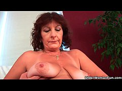 Busty senior lady Alma rubs her hairy cunt with...