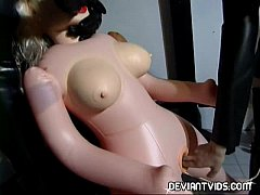 Latex freaks playing with a sex doll