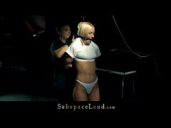 Provocative blonde slave restrained and bondage...