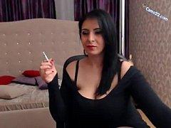 Brunette milf smoking cig and showing huge bobs...