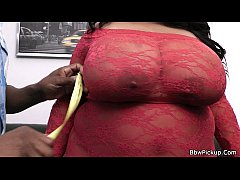 Busty plumper in red lingerie takes black meat