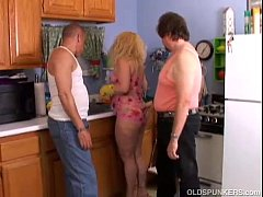 Cute chubby MILF spit roasted in the kitchen