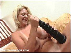 Busty blonde milf riding a monster brutal dildo