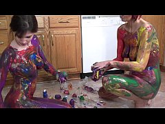 Lavender Rayne and Indigo Augustine playing wit...