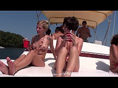 dancing and partying topless on a boat
