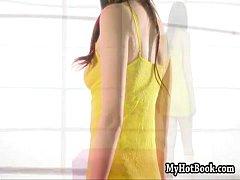 Brunette beauty Kimberly Kane pulls up her shirt a