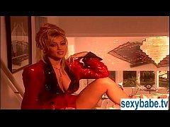 Jill Kelly masturbating on the bed