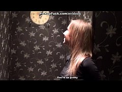 slim blonde shows striptease in the toilet