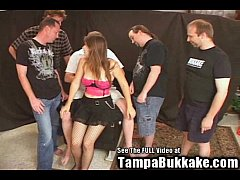 Sexy hot brunette babe gets in a gang bang
