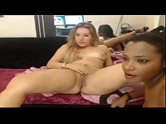 Sexy Interracial lesbians eat each other out on...