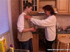 Mature mom and young guy on the kitchen