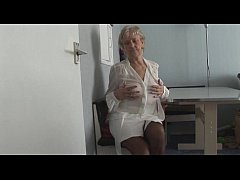 Attractive Granny in short skirt panty teases s...