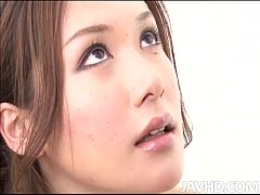 Sassy Emi Orihara in green and white kneels before a horny guy to suck his cock