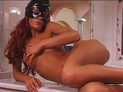 Pervert catwoman masturbates