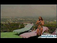 Sunbathing blonde pornstar with big tits