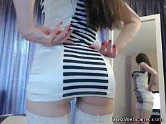 Sexy brunette in stockings teasing on webcam