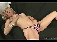 Goodly blonde masturbating pussy and getting na...
