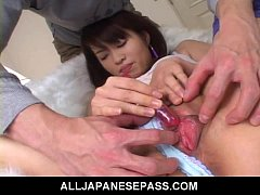 Cute Japanese teen plays with her pussy and pis...