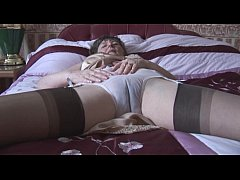 Hairy granny in slip and stockings with see thr...