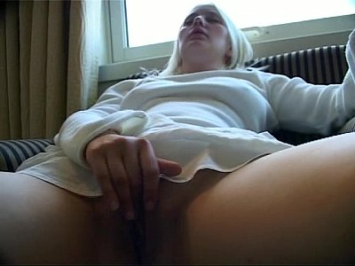 slowly rubbing her clit