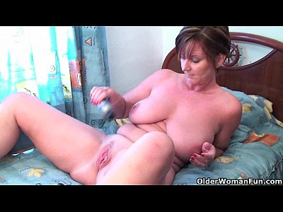 woman in lingerie plays with big dildos