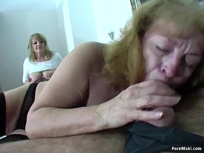 mature woman in between two dicks