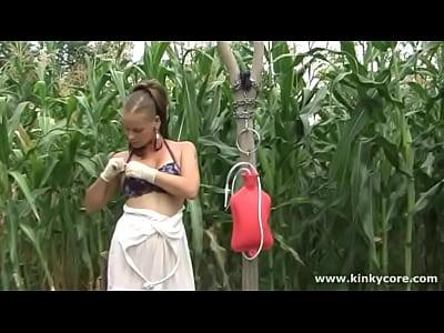 Kinkycore milk enema in the garden 6