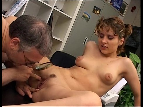 After a tennis game, a young girl plays with a mature cock