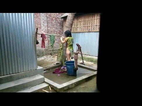 desi girl bathing outdoor for more visit http://sh.st/3b8dG