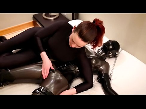 Savannah tickles, tortures and chokes a chained rubber girl
