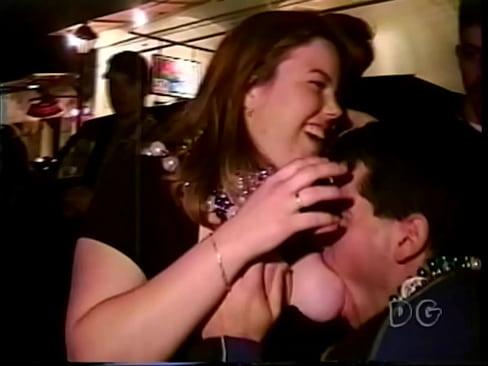 Grabbing mature tits