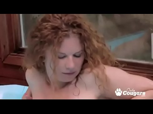 Redheaded Cougar Gina Plays With Herself In A Jacuzzi