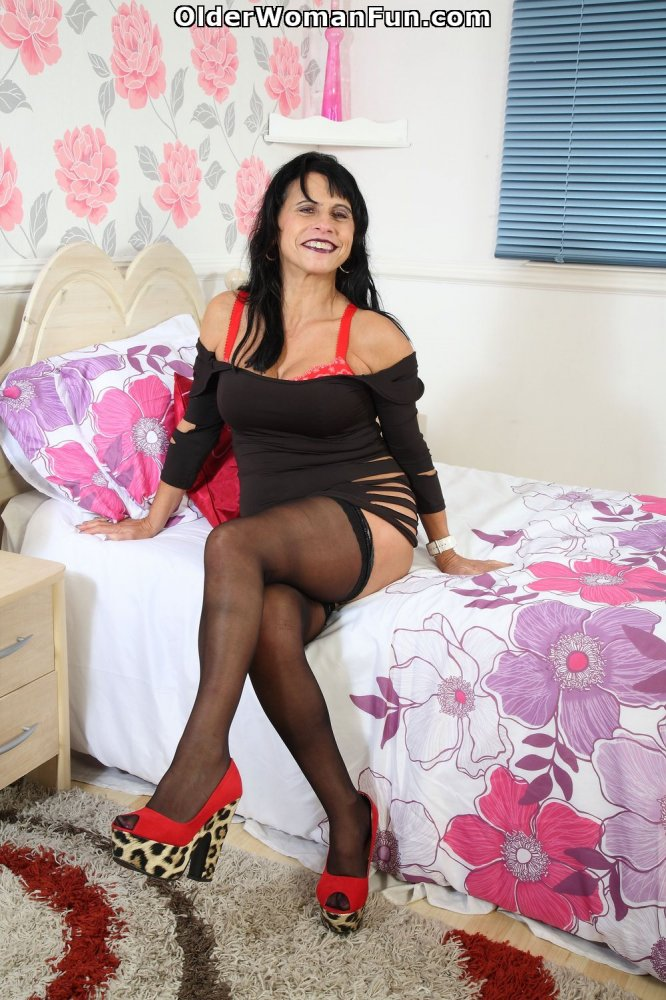 image British milf raven works her nyloned pussy