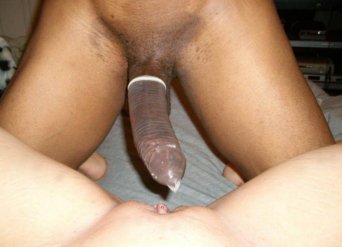 Nude photo of man girl with condom, cum inside girls cervix
