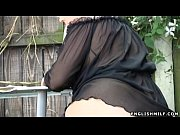 Picture Big butt milf in stockings flashing ass outd...