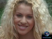 Picture Curly haired blonde Jaqueline Stone giving a...