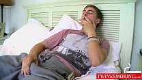 Stunning smoker blows smoke rings while he rubs his dick out