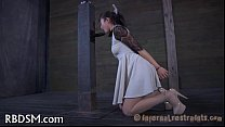 Demeaning a shackled girl