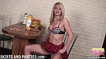 Blonde schoolgirl Sascha flashing her striped panties