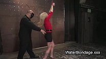 Blonde in ropes dived in water basin