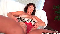 Busty senior lady Alma rubs her hairy cunt with her fingers