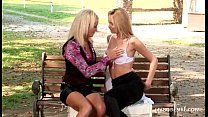 Hot lesbos make out passionately on a park bench