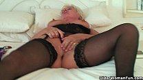 British grandma Sandie in stockings rubs her pierced clit