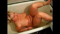 Mature masturbates in bathtub.