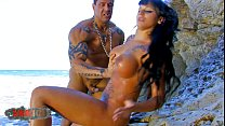 Amazing Bimbo slut fucked at the beach by large cock bodybuilder